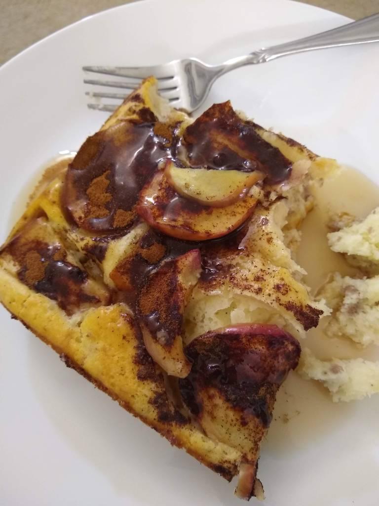 A sausage and cinnamon apple pancake dish.